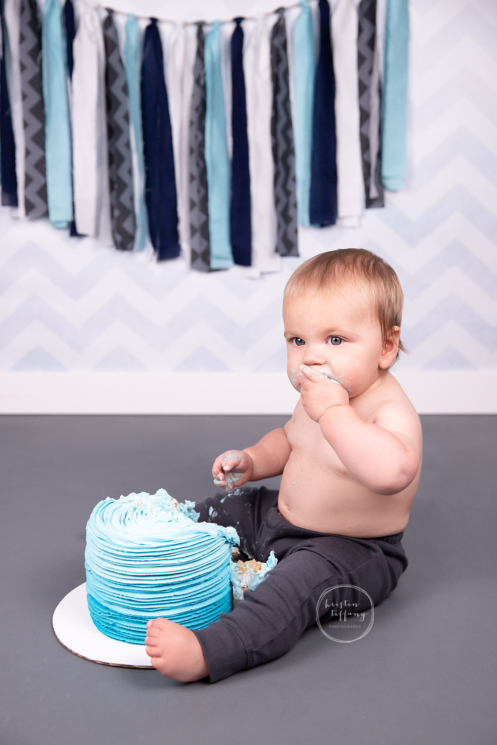 a photo of a baby boy at his cake smash photo session