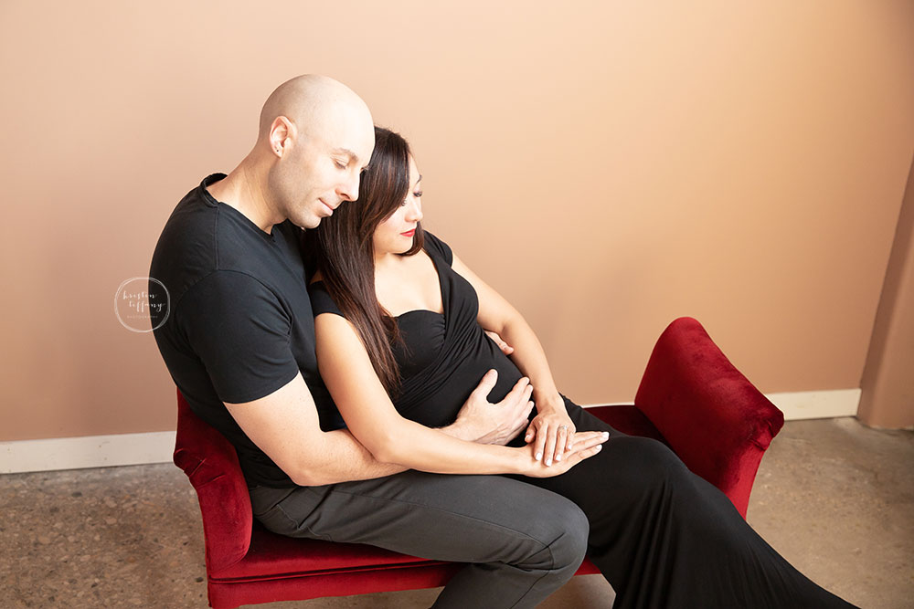 a maternity photo of an expecting mom and her husband at her maternity photoshoot