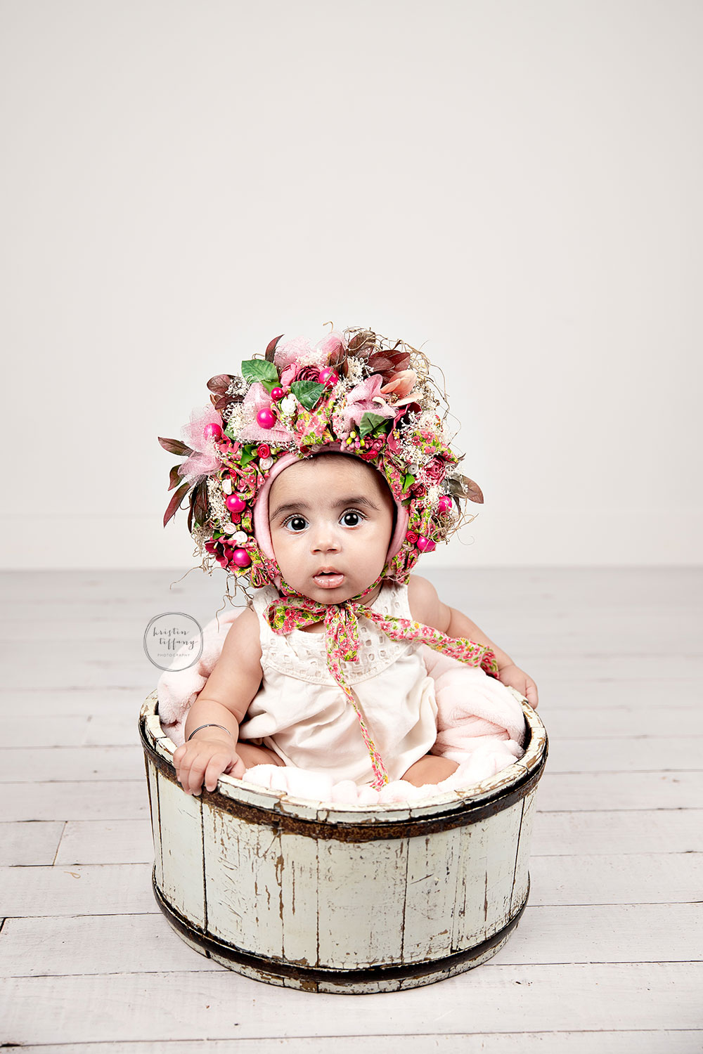 a photo of a baby girl at her photo shoot