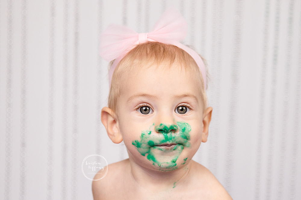 a photo of a baby girl at her cake smash photoshoot
