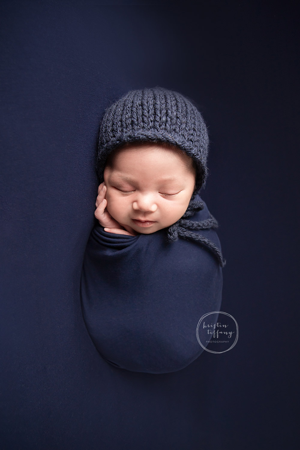 a photo of a baby boy at his newborn photoshoot