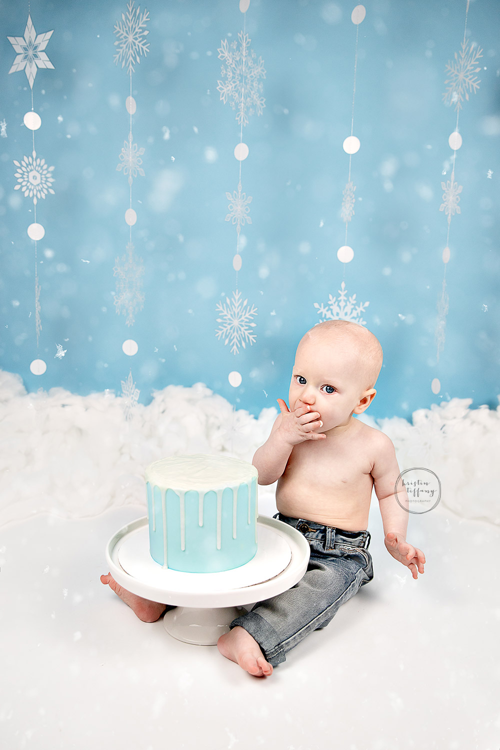 a photo of a baby boy at his cake smash photo shoot