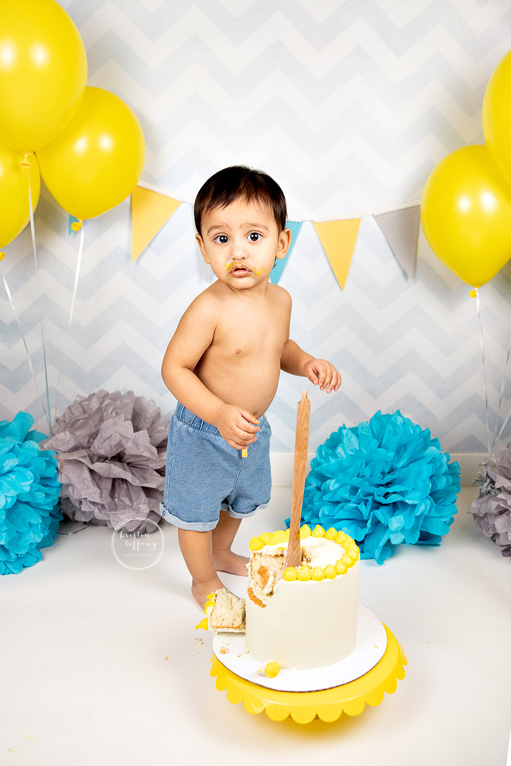 a photo of a baby boy at his cake smash session