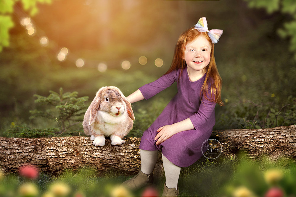 a photo by Kristin Tiffany Photography of a little girl with a bunny