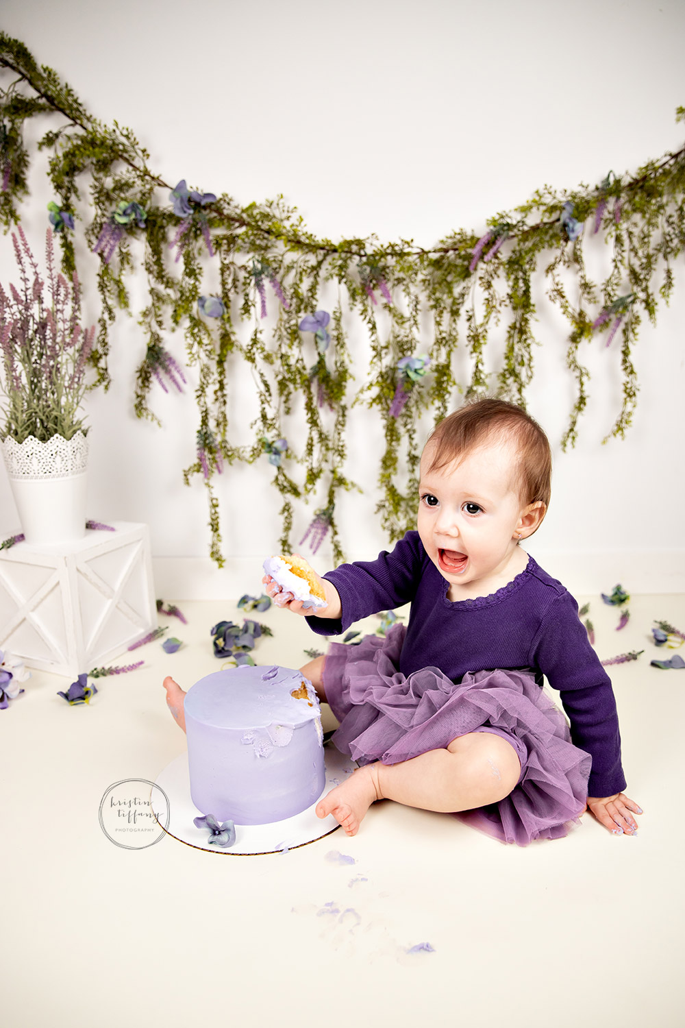 a photo from a cake smash session with Kristin Tiffany Photography in Winnipeg