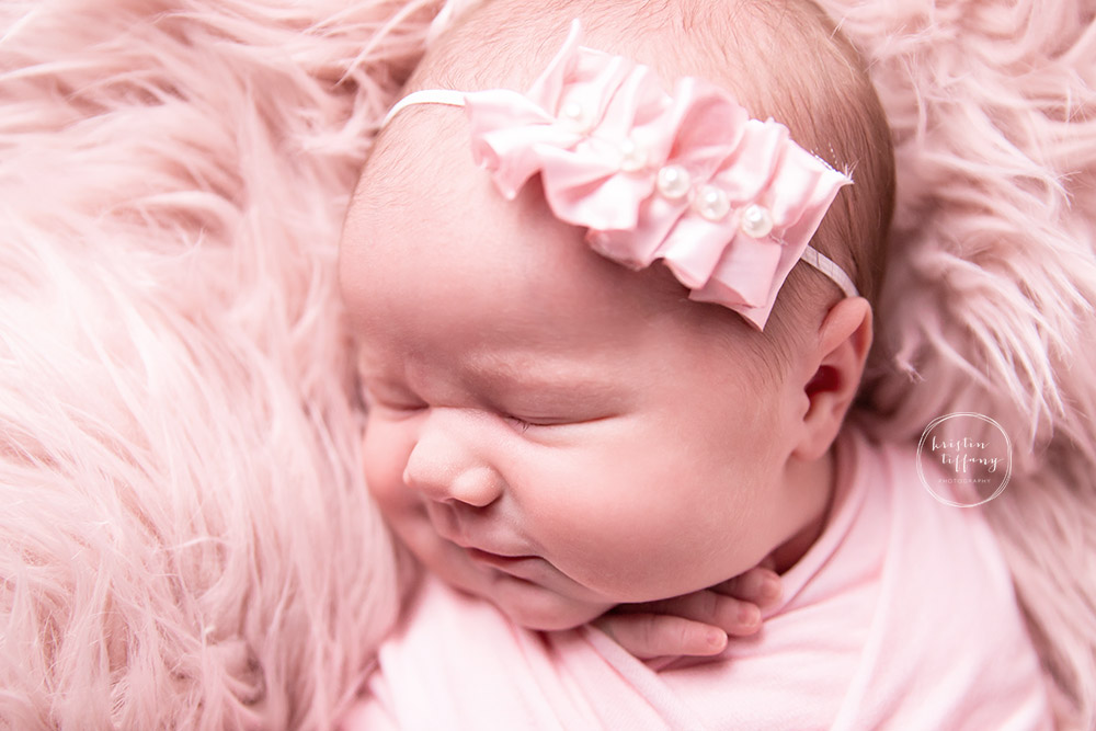 a photo of a newborn smiling with Kristin Tiffany Photography