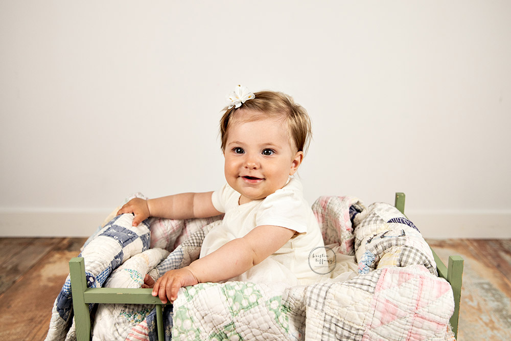a photo of a baby girl at a sitter session with Kristin Tiffany Photography