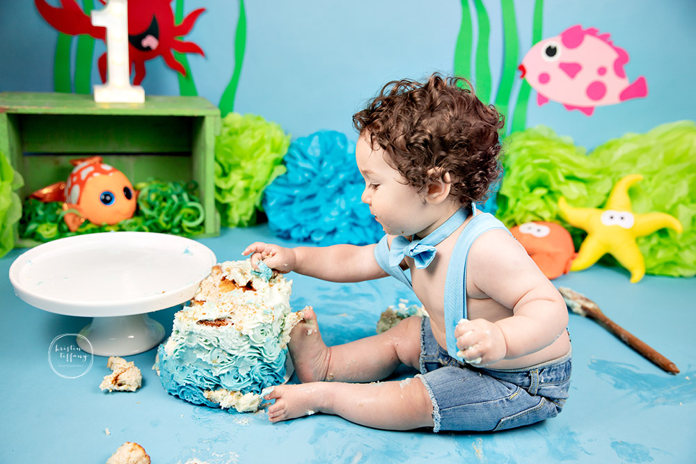 a photo of a baby boy at a cake smash session with Kristin Tiffany Photography