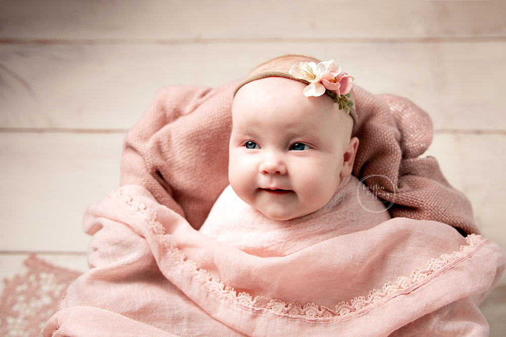 a photo of a baby girl at a photoshoot with Kristin Tiffany Photography