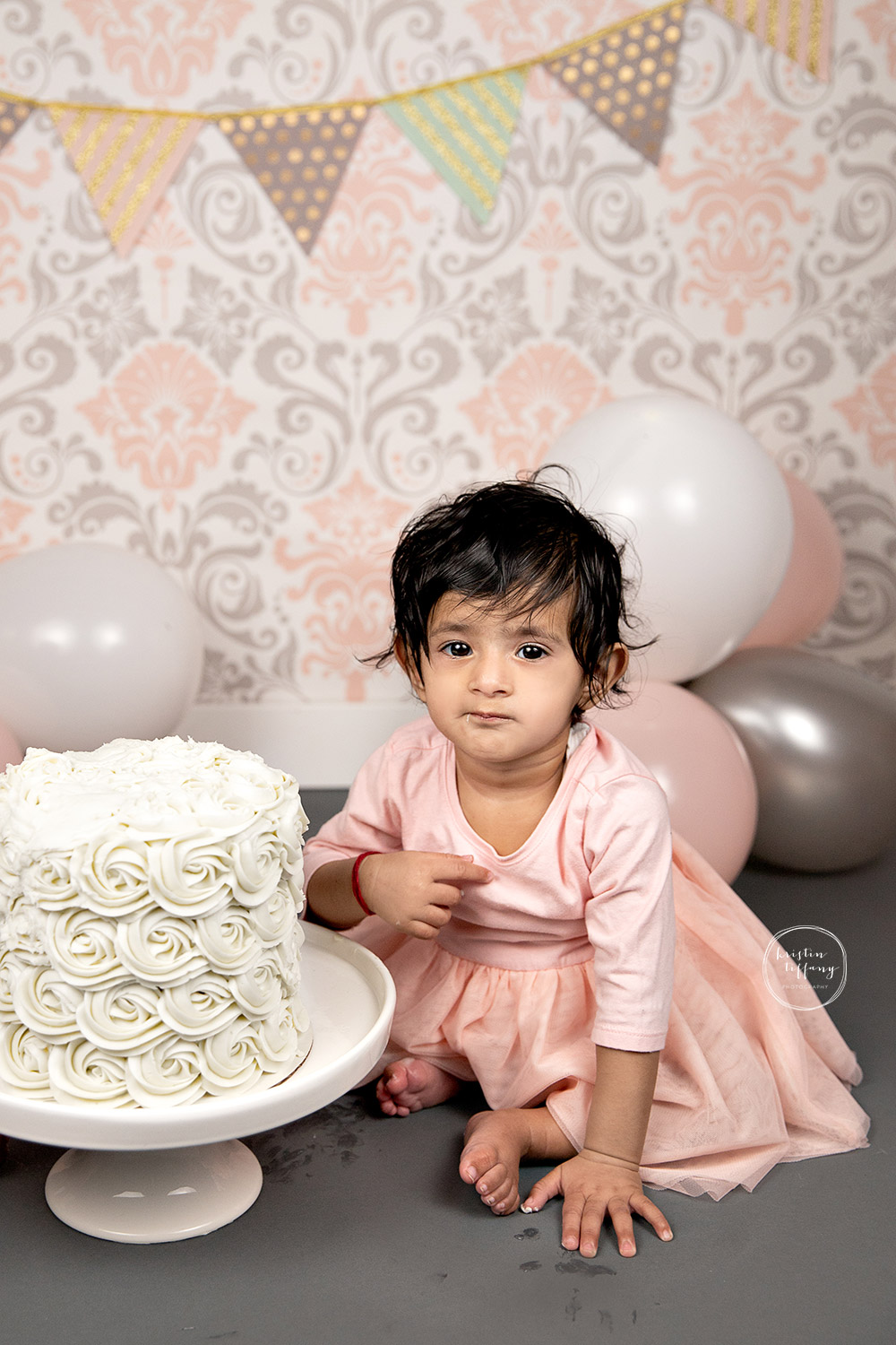 a photo from a twin Cake Smash Session with Kristin Tiffany Photography